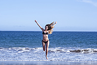 Spain, Tenerife, happy young woman at the sea - SIPF000343