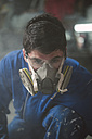 Portrait of a construction worker with protective mask - RAEF001041