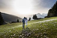 Austria, Tyrol, Couple on alp - MKFF000290