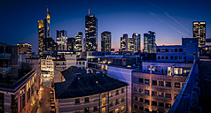 Germany, Frankfurt, Skyline of finanial district in the evening - MPAF000059