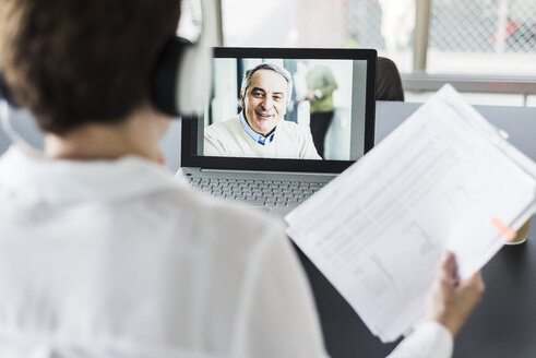 Businesswoman having a video conference in office - UUF006825