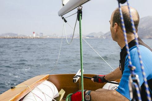 Man sailing with his sailboat at sea - ABZF000330