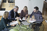 Business people having team meeting in office - RBF004282