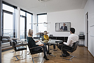 Business people having a video conference in board room - RBF004411