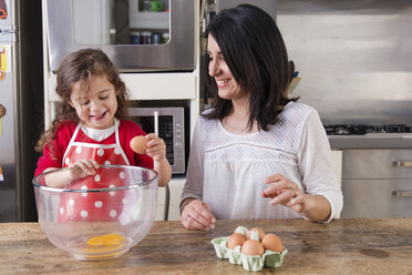 Mother and little daughter baking together - LITF000250