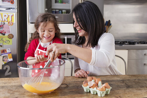 Mother and little daughter baking together - LITF000253
