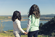 Spain, Burujon, back view of two little girls looking at a lake - ERLF000162