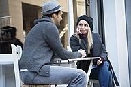 Couple in love holding hands at sidewalk cafe - LFOF000214