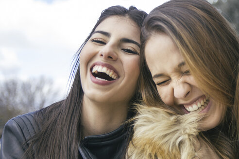 Two laughing young women - ABZF000339