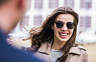Happy young woman wearing sunglasses, portrait - UUF006891