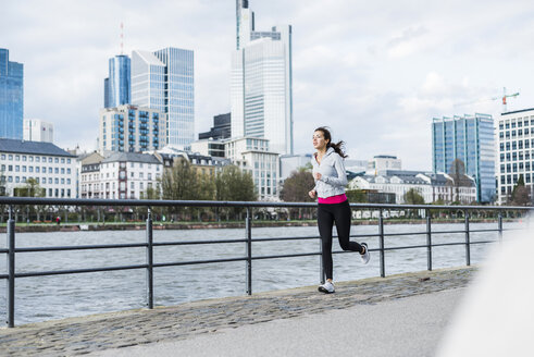 Young woman running at the river - UUF006951