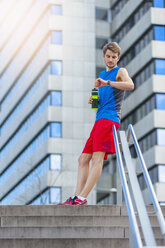 Young sporty man with water bottle and smartwatch - DIGF000262