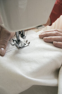 Woman using a sewing machine - ABZF000346