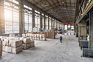 Manager walking through factory hall - DIGF000289