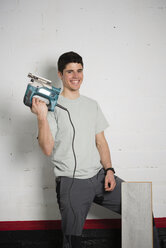 Young man with a jigsaw - RAEF001064