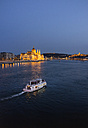 Hungary, Budapest, tourist boats on river danube, parliament building in the background - TKF000441