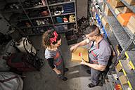 Mechanics in warehouse, searching a box - JASF000686