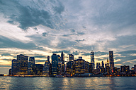 USA, New York City, view from Brooklyn to Manhattan skyline and East River at sunset - GIOF000885