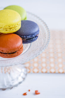 Colourful macarons on a cake stand - OJF000134