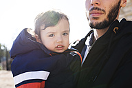 Portrait of little boy on his father's arms - GEMF000864
