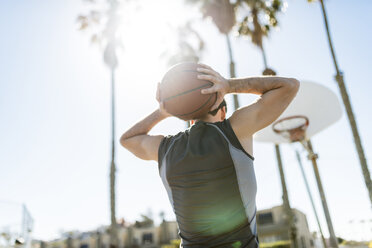 Young man practicing on outdoor court - LEF000096