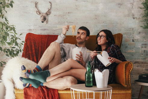 Young couple eating chinese take-away food at home - RTBF000144