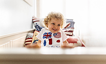 Portrait of happy little boy at home - MGOF001754