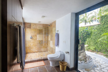 Toilet and shower in a residential home - ABAF001981