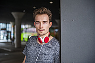 Portrait of young man with red headphones - DIGF000331