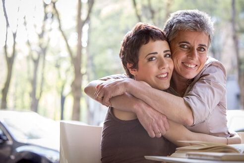 Portrait of happy mother and adult daughter hugging each other - ZOCF000030