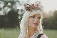 Girl with flowers in her hair during sunset - ANHF000023