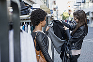 Young women shopping for clothes in the city - MAUF000476