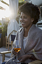 Young woman sitting in bar drinking aperitif - MAUF000488