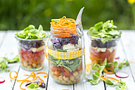 Rainbow salad in glasses with chickpeas, tomatoes, carrots, red cabbage, red radishes, lettuce and feta cheese - SARF002695