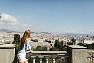 Spain, Barcelona, Young woman enjoying view of the city - JRFF000555