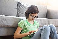 Girl using digital tablet at home - LVF004788