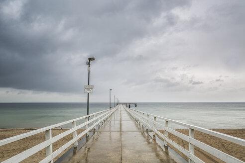 Germany, Timmendorf Beach, view to sea bridge, rainy weather - ASCF000572