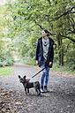 Woman walking the dog - MAUF000497