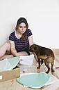 Woman sitting on the floor reading instruction - RTBF000147