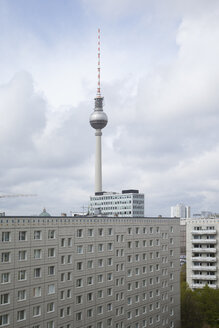 Germany, Berlin, view to television tower with concrete tower blocks in the foreground - JMF000376