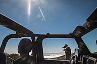 Spain, Tenerife, man taking picture beside car in El Teide region - SIPF000368