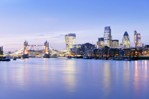 UK, London, skyline with River Thames and Tower Bridge at blue hour - BRF001346