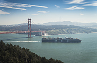 USA, California, San Francisco, container ship at Golden Gate Bridge - STC000225