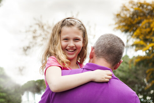 Portrait of happy girl on her father's arms - VABF000464