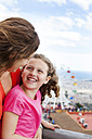 Spain, Barcelona, portrait of happy girl face to face with her m,other - VABF000467