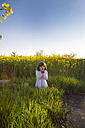 Little girl standing in rape field - LVF004804