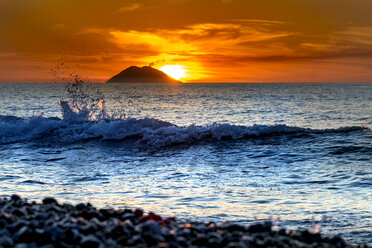 Italy, Sicily, Aeolian Islands, View to Isola Stromboli at sunset - CSTF001055
