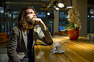 Young hipster businessmamn waiting in cafeteria - ZOCF000103