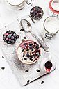 Bowl of vegan coconut yogurt  with berries, puffed amaranth, pumpkin seeds and raspberry pulp - SBDF002792