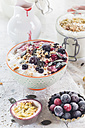 Bowl of vegan coconut yogurt  with berries, puffed amaranth, pumpkin seeds and raspberry pulp - SBDF002795